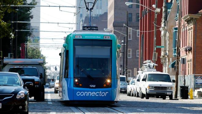 Cincinnati Bell Connector travels along Elm Street Tuesday Sept. 6, 2016.