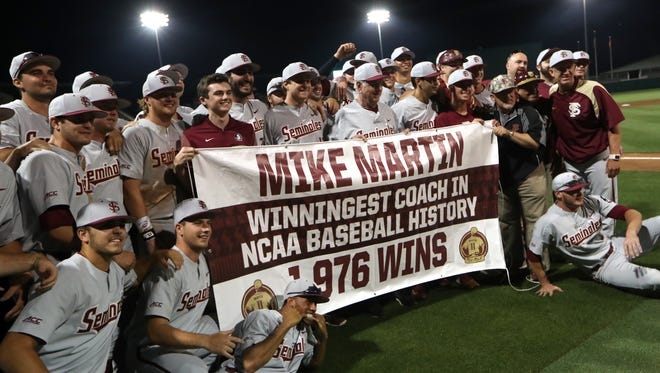 FSU Head Coach Mike Martin celebrates with his team as he becomes the NCAA's all-time winningest coach with a 3-2 victory over Clemson during their game at Doug Kingsmore Stadium in Clemson, S.C. on Saturday, May 5, 2018.