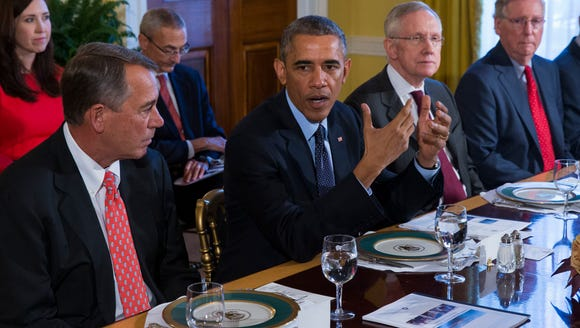 President Obama with John Boehner, left, and Mitch