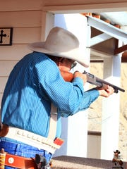 Exeter resident Badmann Bob takes aim at a shooting event earlier this year.