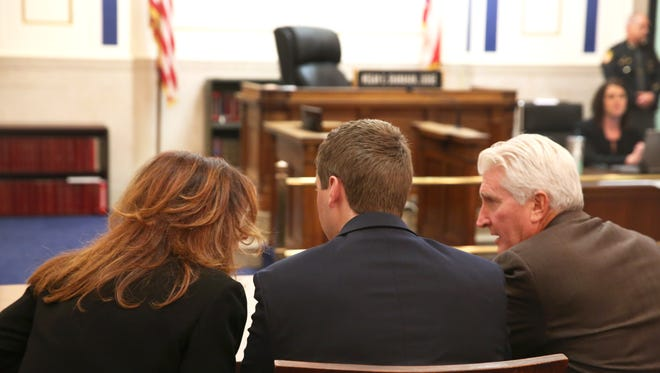 Former University of Cincinnati Police Officer Ray Tensing, center, and attorneys Gwen Callender and Stew Mathews wait for Judge Megan Shanahan to call court into session during jury deliberations. A juror from a long-ago case says he thinks race can play a role in deciding cases.