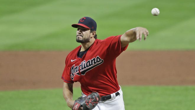 Cleveland Indians relief pitcher Brad Hand delivers in the ninth inning in a baseball game against the Cincinnati Reds, Wednesday, Aug. 5, 2020, in Cleveland.
