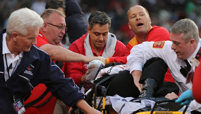 Tonya Carpenter is attended to by medical staff after she was hit by a broken bat Friday at Fenway Park