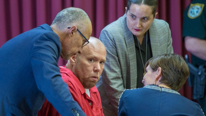 Robert Hobart's legal team surrounds him after his death penalty was changed to life in prison without possibilty of parole during resentencing at the Santa Rosa County Court House in Milton on Tuesday, February 20, 2018. Hobart was originally sentenced to death for his 2010 double murder conviction.