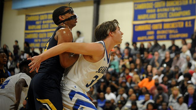 Decatur's Churchill Bounds boxes out Kent's Manny Camper at the Bayside Conference boys basketball Championship on Wednesday, Feb. 22, 2017 at Cambridge-South Dorchester High School.