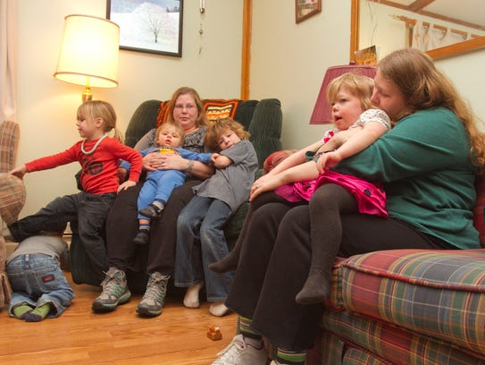 Kerry Valentine, at left, is surrounded by her children