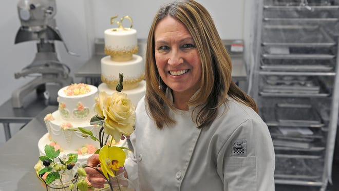 Cheryl Weise, sugar artist and owner of Frosted Memories, shows off some of her custom cakes and sugar creations.
