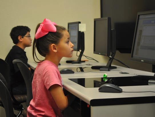 Yazmin Ortega and Armani Montes practice typing at