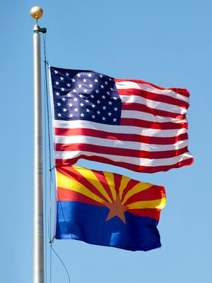 Flag pole with United States and Arizona flags.