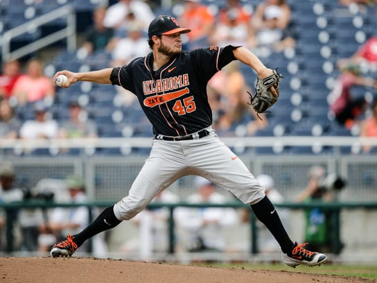 Oklahoma State starting pitcher Thomas Hatch (45) works against Arizona during the first inning of an NCAA men's College World Series baseball game in Omaha, Neb., Saturday, June 25, 2016. (AP Photo/Nati Harnik)