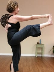 Anna Withrow of Yoga Bird, Fort Myers, demonstrates