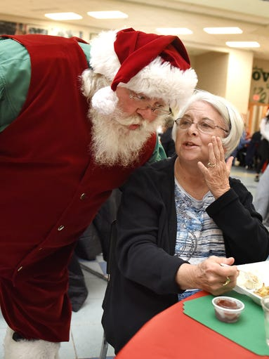 Gale Ford whispers a suggestion to Santa Claus during
