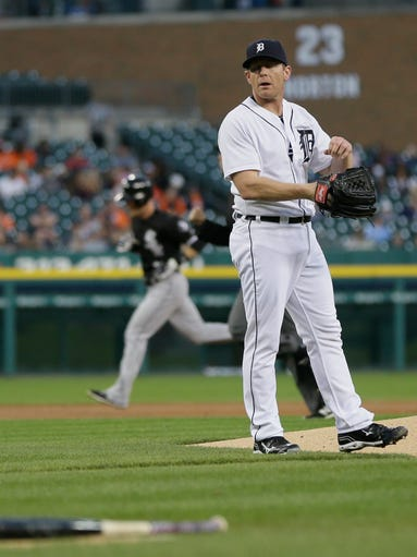 Detroit Tigers starting pitcher Randy Wolf stands on