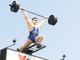"""The iconic """"Barbell Man"""" spins atop the York Barbell"""
