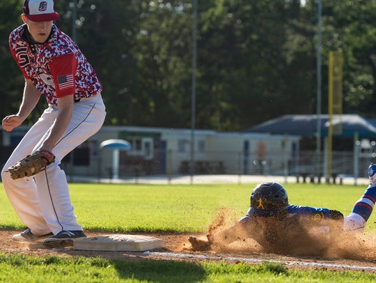 Greencastle's first baseman Spencer Meyers tries unsuccessfully