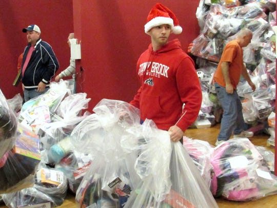 Arctic League volunteers sort gift bags Christmas morning