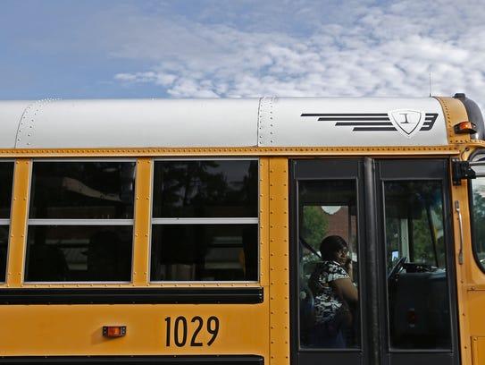 A Leon County School bus driver transports children