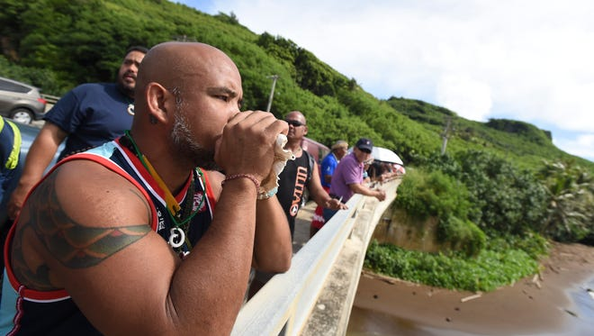 Roman Dela Cruz participates in the I Fiestan Sahyan Tasi - The Festival of the Canoes opening ceremony at the Valley of the Latte in Talofofo on Oct. 1, 2016.