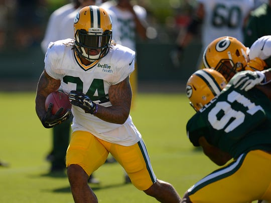 Green Bay Packers running back Rajion Neal (34) runs with the ball during training camp practice at Ray Nitschke Field on Saturday, Aug. 1, 2015.