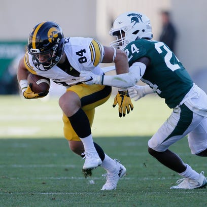 Nick Easley, left, has 27 receptions for Iowa this