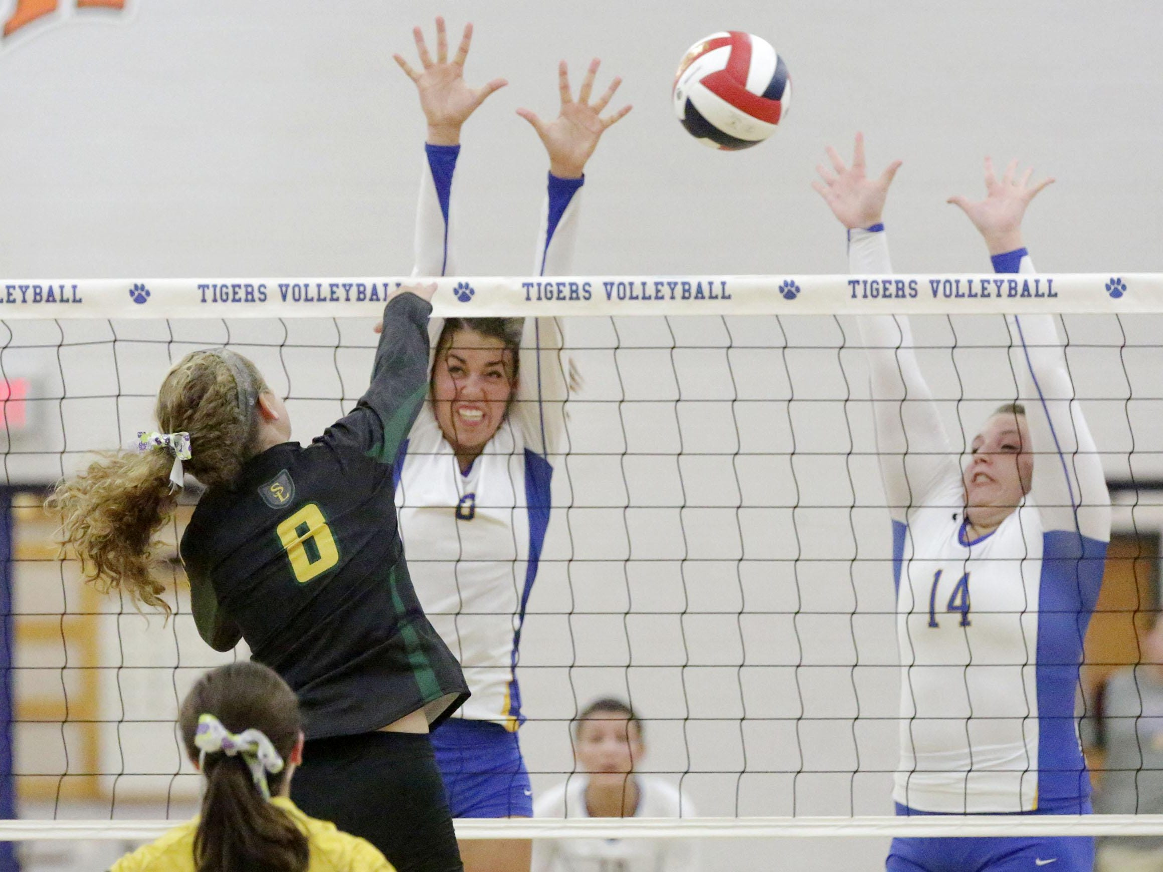 Howards Grove's Samantha Yancey (8) and Zaylie Kleinman (14) go up for the block against Sheboygan Lutheran's Emma Egbert on Tuesday night.