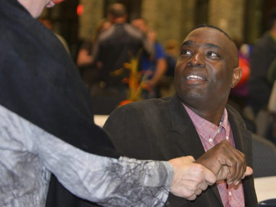 Antwone Fisher is thanked by area residents after speaking Wednesday, Oct. 14, at Silver Lake College in Manitowoc about his struggles growing up ranging from an abusive foster family to living on the streets.