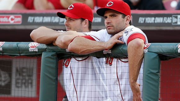 The Reds' Chris Heisey (left) and Joey Votto watch the action during the first inning June 3 against the Giants at Great American Ball Park.