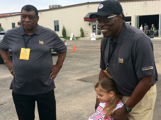 Former Green Bay Packers Dave Robinson (left) and John Brockington with Natasha Fuller in Green Bay Sunday.