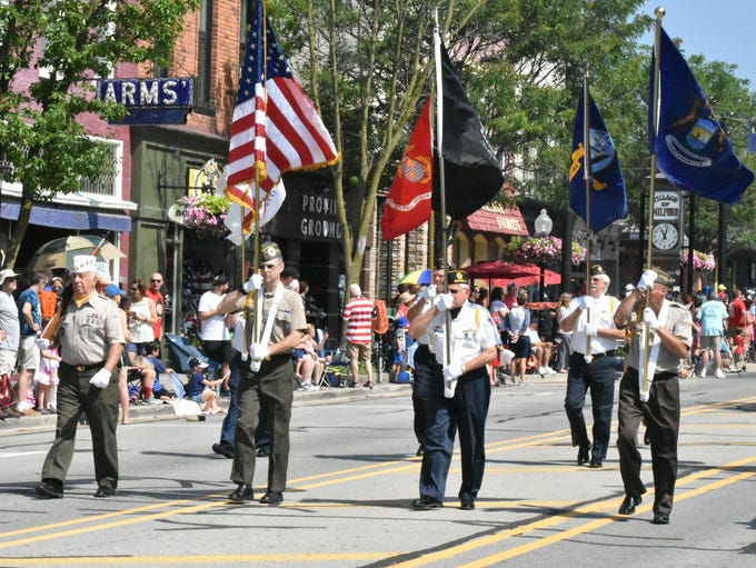 A military color guard stepped off to start Milford's