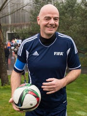 New FIFA President Swiss Gianni Infantino arrives with a ball for a friendly soccer match at the home of FIFA in Zurich, Switzerland, Monday, Feb. 29, 2016..