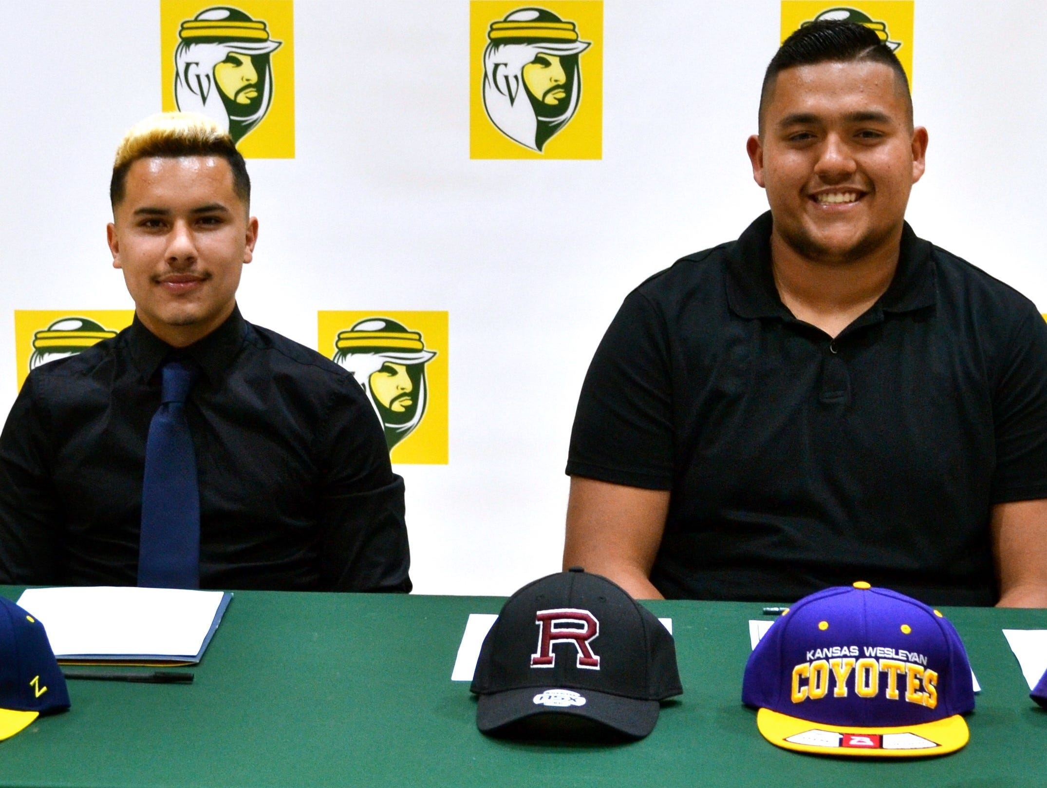 Coachella Valley seniors Wilfredo Ortiz and Nick Hernandez smile before their signed their national letters of intent on Friday.