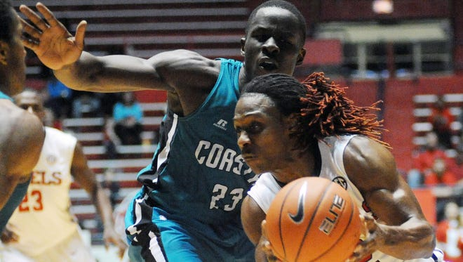 Mississippi guard Stefan Moody (42) dribbles against Coastal Carolina forward Badou Diagne (23) during an NCAA college basketball game, Thursday, Dec. 18, 2014 in Oxford, Miss.  (AP Photo/Oxford Eagle, Bruce Newman) NO SALES; MANDATORY CREDIT