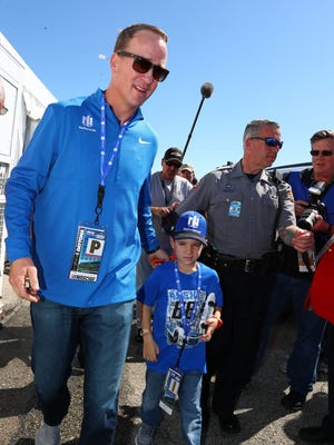Former NFL quarterback and pace car driver Peyton Manning leaves the drivers meeting during pre-race festivities prior to the start of the Daytona 500.