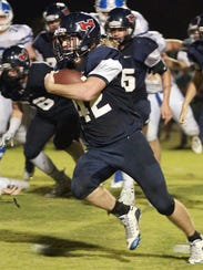 White House Heritage's Michael Mcewing rushes against