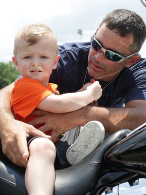 Dan Daniels with his autistic son Dane (2) at the Sumner County Autism benefit ride in Gallatin, TN on Saturday June 2, 2018.