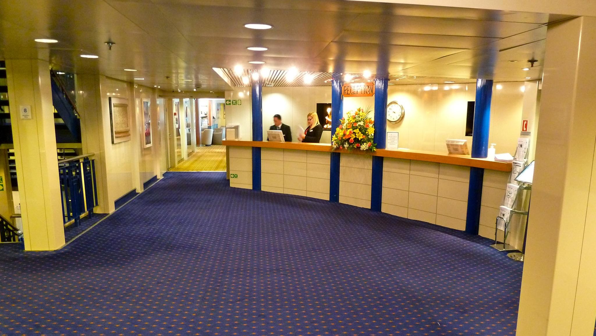 The reception foyer is located on the starboard side of the midships stairtower on Magellan Deck.