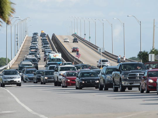 Traffic backs up through the Bob Sikes Bridge toll plaza early for the Blue Angels air show at Pensacola Beach on Saturday July 8, 2017.