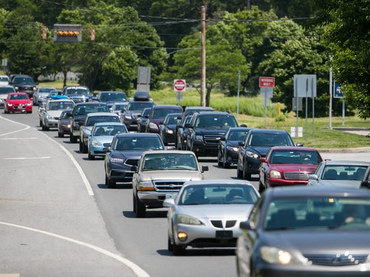 Traffic along Route 13 near Middletown moves slowly as the Memorial Day weekend begins with people heading toward the beach.