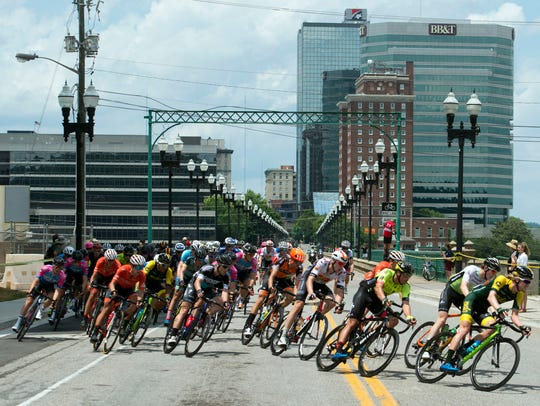 Racers cross Gay Street Bridge in the men's 2018 USA Cycling Pro Road National Championships on Sunday.