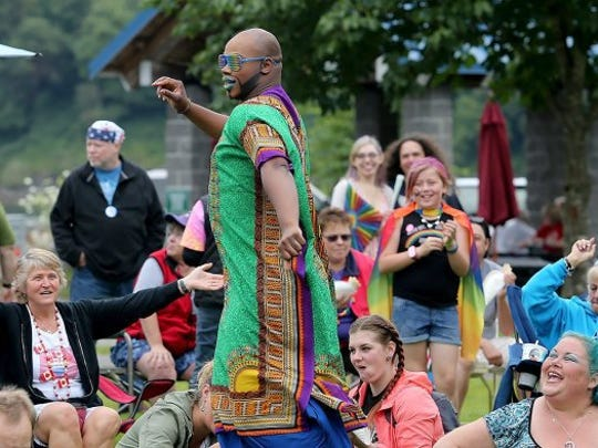 Isaiah Esquire of the Caravan of Glam show dances with help from the audience at the 2016 Kitsap Pride festival on Saturday, July 16, 2016. LARRY STEAGALL / KITSAP SUN