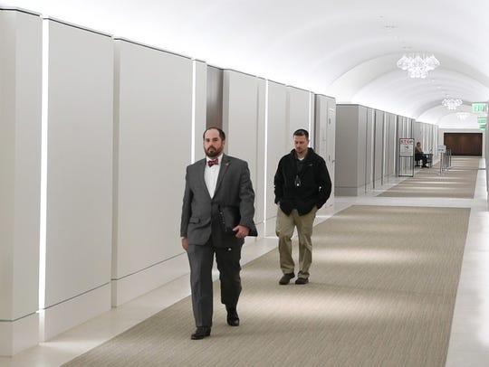Legislators and visitors travel a new 452 ft tunnel