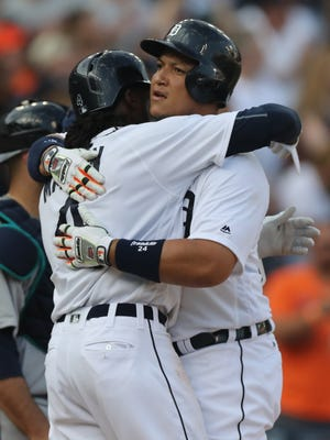 Detroit Tigers first baseman Miguel Cabrera hits a two-run homer against the Seattle Mariners' Nathan Karns scoring Cameron Maybin during the first inning Monday, June 20, 2016 at Comerica Park in Detroit, MI.