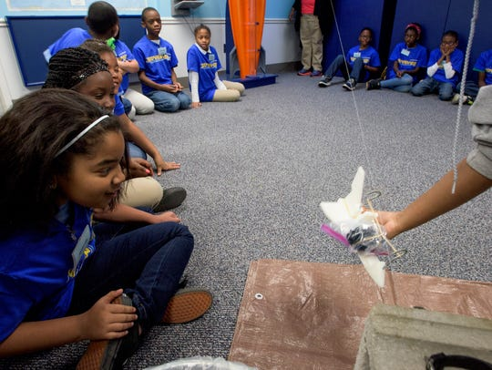 Garrett Elementary School pupils check to see if their