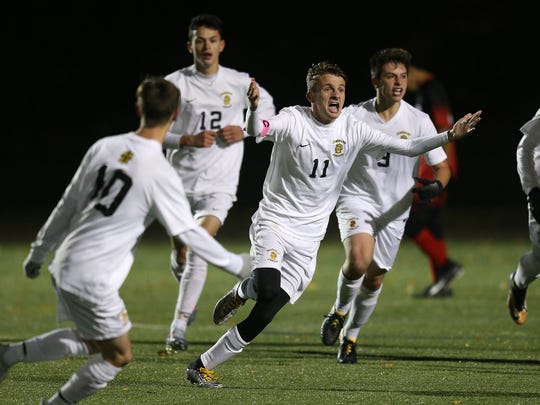 McQuaid's Dylan Duffy celebrates his game winning goal to beat Hilton 2-1 for the Class AA championship.