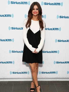 Happy Birthday, Selena Gomez! The singer turned 25 on July 22, 2017 and to celebrate, we've rounded up some of her hottest looks, including this long-sleeved, black-and-white ensemble she wore during a visit to SiriusXM Studios on June 5, 2017 in New York.