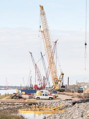 Construction of the new Pensacola Bay Bridge continues in Gulf Breeze on Tuesday, Dec. 26, 2017.