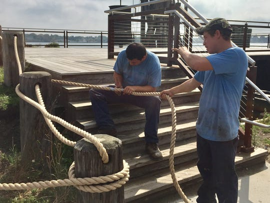 Joe Ventimiglia, left, and Jim Hamilton of St. Clair Landscaping and Irrigation, replace the decorative rope at the Blue Water River Walk on Wednesday, Sept. 20, 2017.