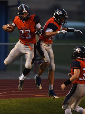 Scenes from Friday's game between the Harrison Raiders and Muncie Central.