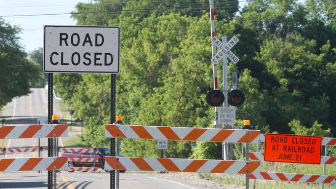 Chilson Road is closed at the railroad crossing between Grand River and the I-96 overpass Wednesday, June 21, 2017.