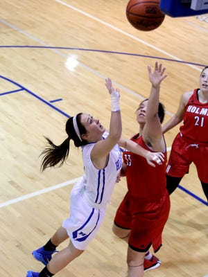Highlands G Haley Coffey attempts a shot in the girl's basketball game between Highlands and Holmes High School January 29, 2015 at Highlands.